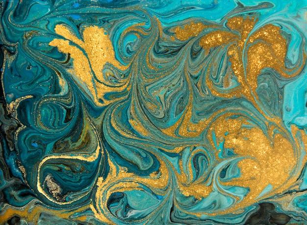 Blau und goldmarmormuster. goldene marmorflüssigkeitsbeschaffenheit. Premium Fotos