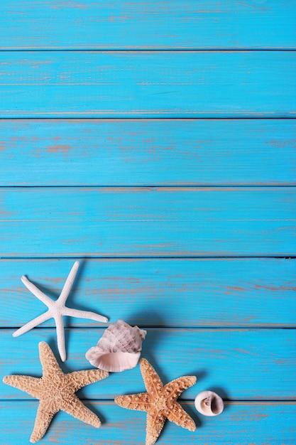 Blaue alte hölzerne vertikale der sommerstrandnahthintergrundsterne Premium Fotos