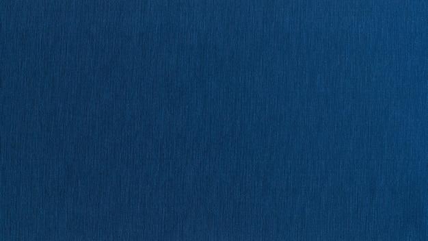 Blaue strukturierte gewellte beschaffenheitsfahne der festen nahtlosen oberfläche des baumwollgewebes Premium Fotos