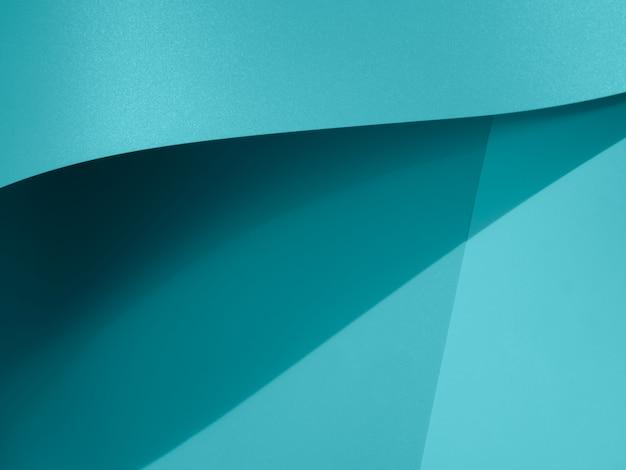 Blaue zusammenfassung der nahaufnahme gebogenes einfarbiges papier Kostenlose Fotos