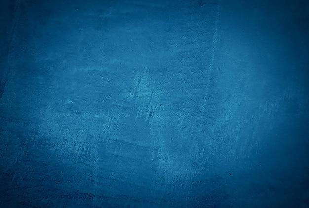Blauer betonbeschaffenheitswandhintergrund der weinlese grunge mit vignette. Premium Fotos