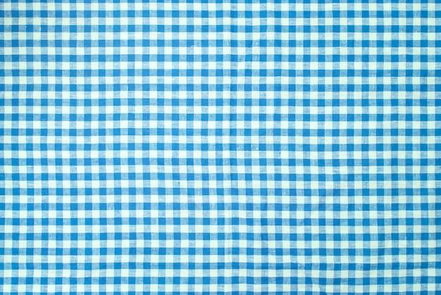 Blauer karierter tischdeckenhintergrund Premium Fotos