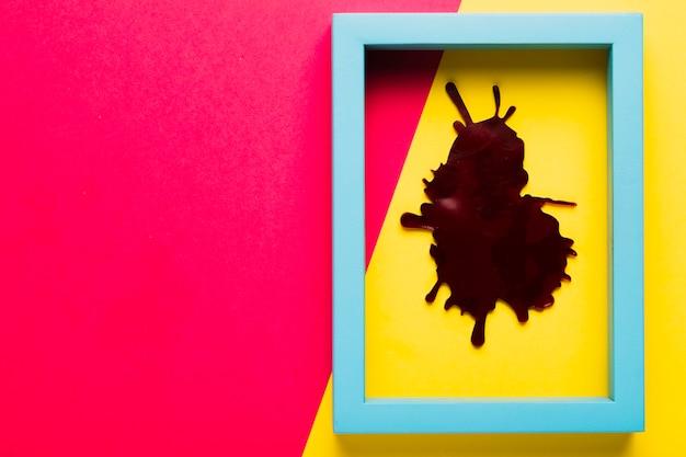 Blauer rahmen der draufsicht mit fleck und kopieraum Kostenlose Fotos