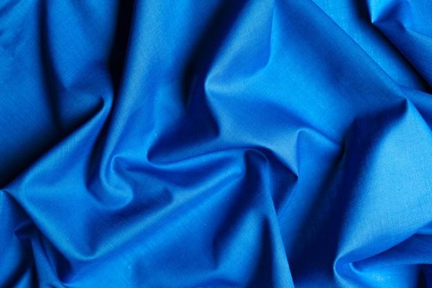 Blauer seidenstoff hintergrund Premium Fotos