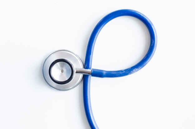 Blauer stethoskophintergrund der draufsicht Premium Fotos