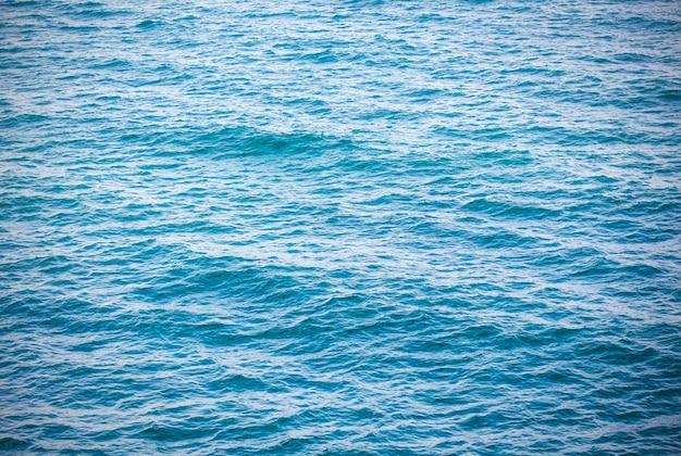 Blauer türkiswassermeerozeanhintergrund Premium Fotos