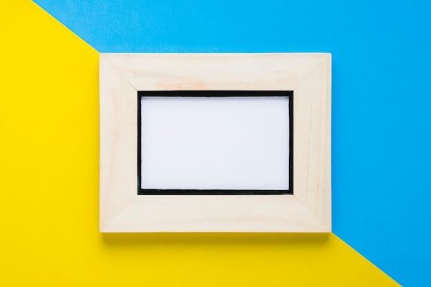 Blauer und gelber hintergrund mit leerem rahmen Kostenlose Fotos