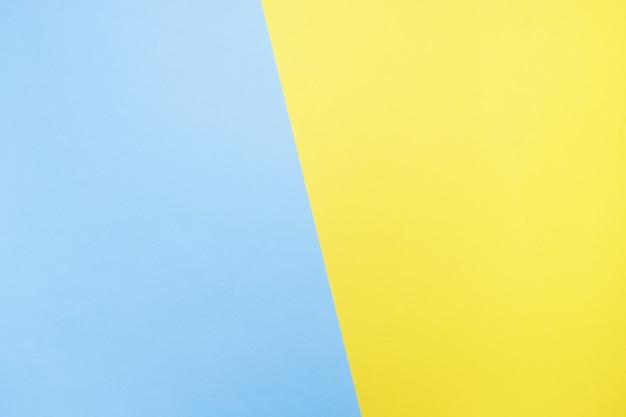 Blauer und gelber hintergrund. papierbeschaffenheit nahansicht Premium Fotos