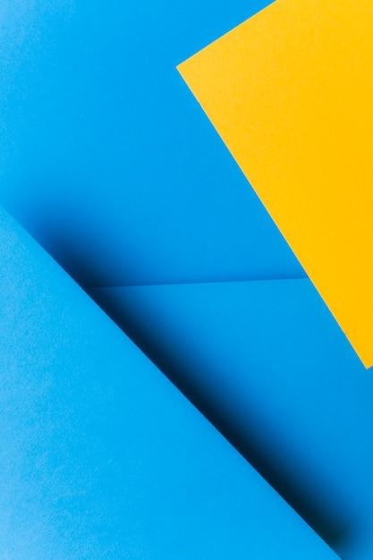 Blauer und gelber papierhintergrund der farbe zwei Kostenlose Fotos
