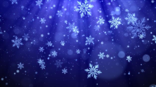 Blauer weihnachtshintergrund mit schneeflocken, glänzenden lichtern und partikelbokeh im eleganten thema. Premium Fotos