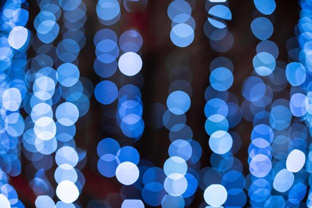 Blaues bokeh unscharfer lichthintergrund Premium Fotos