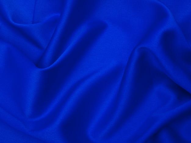 Blaues seidengewebe für hintergrund oder beschaffenheit. Premium Fotos