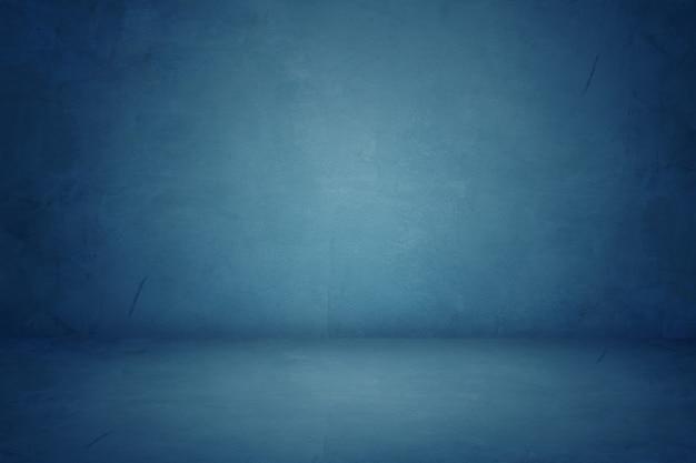 Blaues zementstudio und dunkler ausstellungsraumhintergrund Premium Fotos