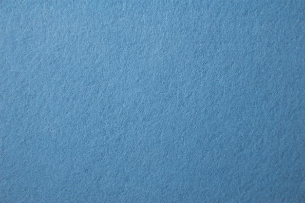 Blaufilzbeschaffenheit für hintergrund Premium Fotos