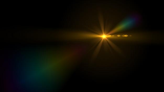 Blendenflecklicht über schwarzem hintergrund. Premium Fotos