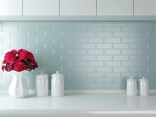 Blumenvase mit dekoration auf weißer küchenarbeitsplatte Premium Fotos