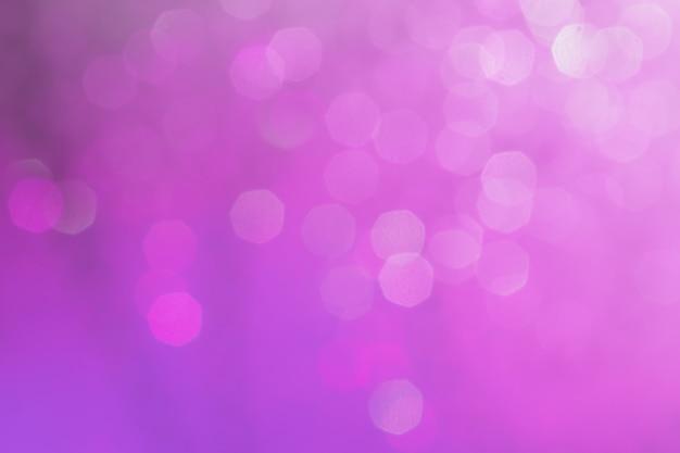 Bokeh abstrakte textur. schöner weihnachtshintergrund in den purpurroten farben. unscharf gestellt Premium Fotos