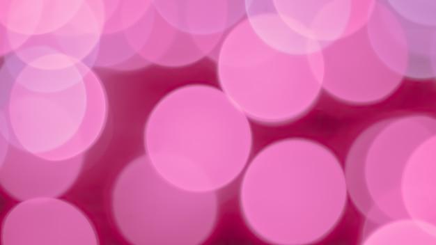 Bokeh abstrakter hintergrund mit rosa blasenlichtfarbe Premium Fotos