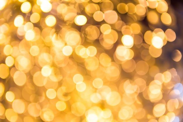 Bokeh defokussiert gold abstrakte weihnachten hintergrund Kostenlose Fotos