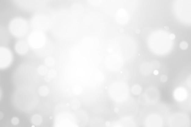 Bokeh-zusammenfassung unscharfer silberner und weißer schöner hintergrund. weiches farblicht glitzert. Premium Fotos