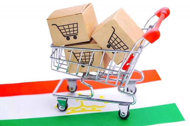 Box mit einkaufswagen und tadschikischer flagge Premium Fotos