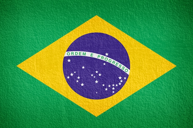Brasilien-flaggenmuster auf der betonmauer Premium Fotos