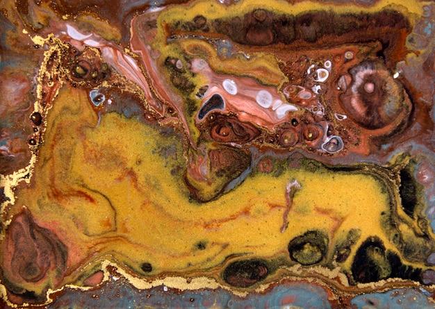Bronze und gold marmorierung. goldene marmorflüssigkeitsbeschaffenheit. Premium Fotos