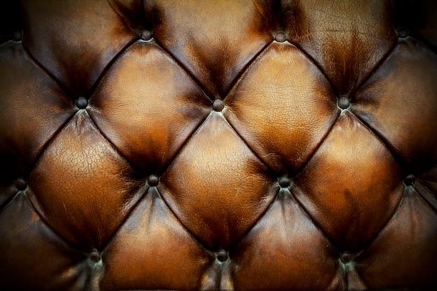 Brown-lederpolsterungs-hintergrund Premium Fotos