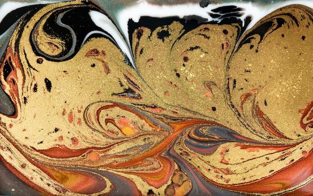 Brown und gold, die hintergrund marmorieren. goldene marmorflüssigkeitsbeschaffenheit. Premium Fotos