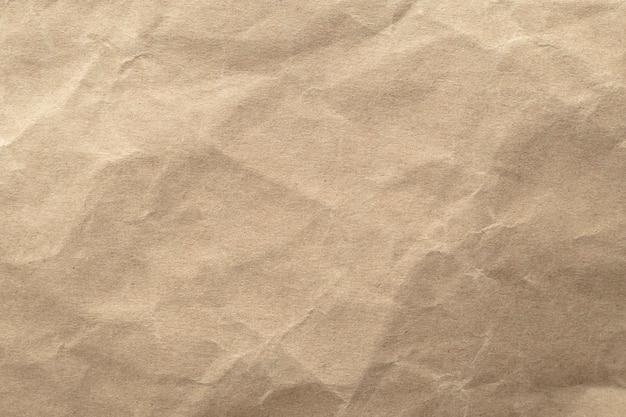 Brown zerknitterte papierbeschaffenheitshintergrund. Premium Fotos