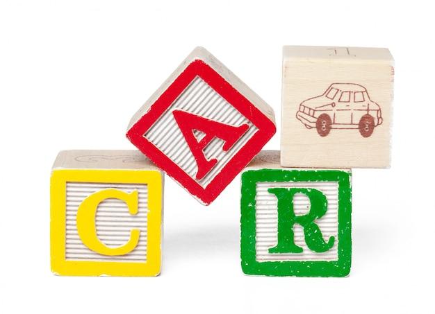 Bunte alphabetblöcke. wort auto isoliert Premium Fotos
