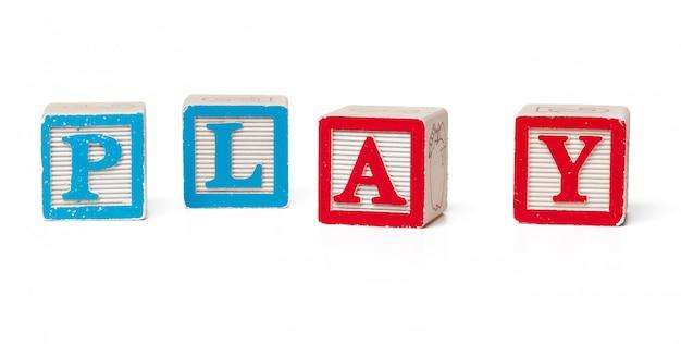 Bunte alphabetblöcke. wortspiel isoliert Premium Fotos