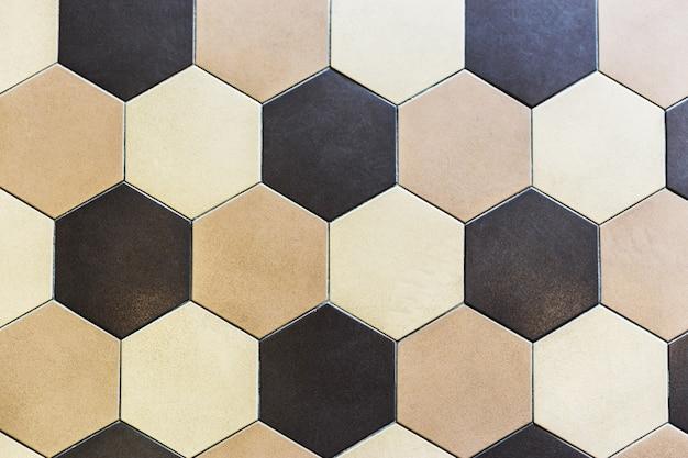 Bunte marmorhexagonfliesen. beige und braun Premium Fotos