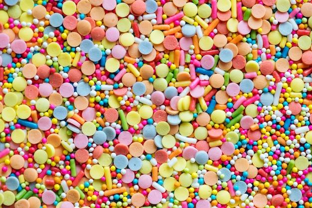 Buntes confetti besprüht strukturierten hintergrund Kostenlose Fotos