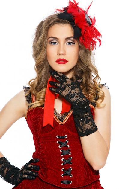 Burleske. attraktives mädchen im schönen kleid Kostenlose Fotos