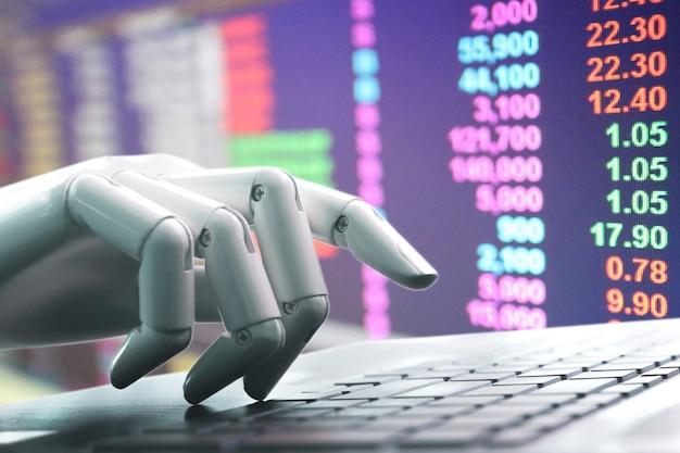 Chatbot-roboter, der die computertastatur von hand drückt, kommt von der investition in den marionettenmarkt Premium Fotos