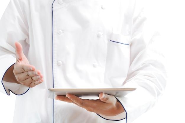 Chef, der digitale tablette verwendet Premium Fotos