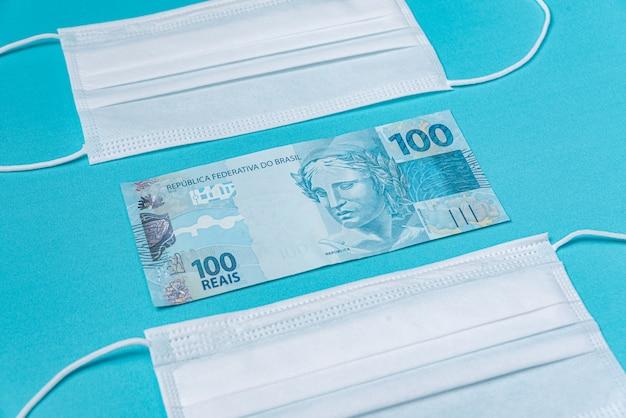 Chirurgische maske und brasilianisches echtgeld, Kostenlose Fotos