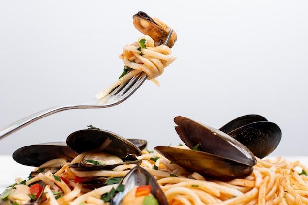 Close-up leckere pasta mit muscheln Kostenlose Fotos