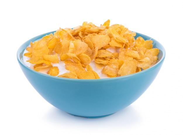 Corn flakes mit milch in der schüssel getrennt Premium Fotos