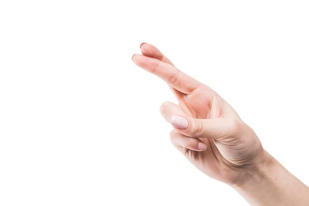Crop hand mit gekreuzten fingern Kostenlose Fotos