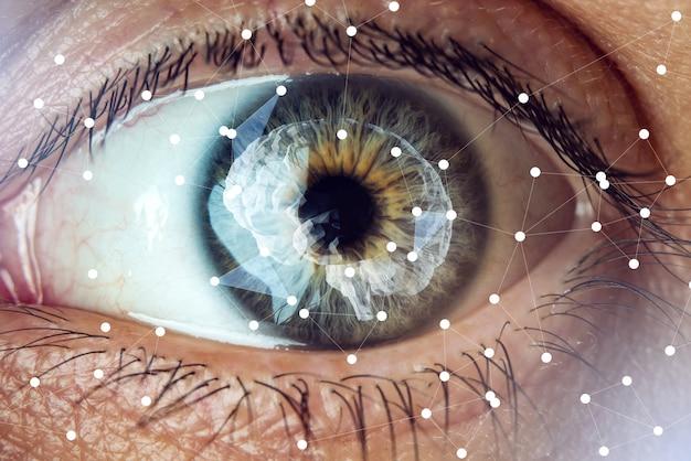 Das menschliche auge mit dem bild des gehirns in der pupille. konzept der künstlichen intelligenz Premium Fotos