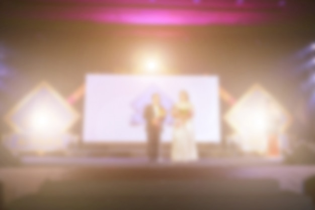 Defocus der success-leute auf der bühne mit beleuchtung bei der preisverleihung Premium Fotos