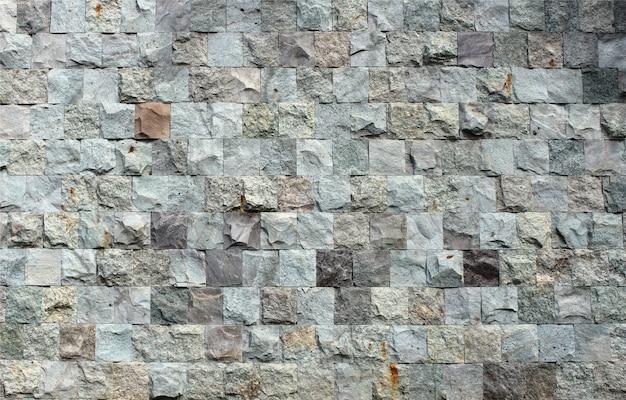 Dekorative quadratische steinbacksteinmauerbeschaffenheit Premium Fotos