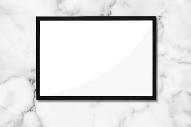 Der schwarze rahmen auf dem marmorhintergrund. für werbung und artwork. Premium Fotos