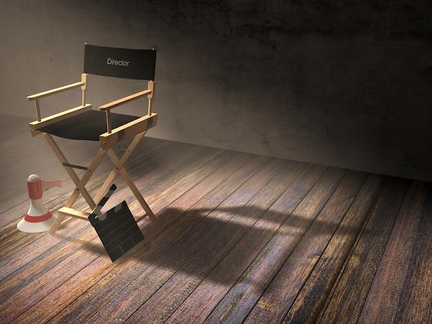 Der stuhl des direktors mit klöppelbrett und megaphon in der dunkelkammerszene mit scheinwerferlicht Premium Fotos