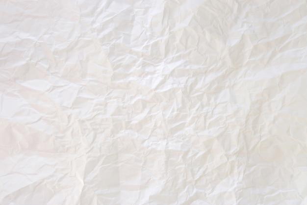 Der zerknitterte papierhintergrund Kostenlose Fotos