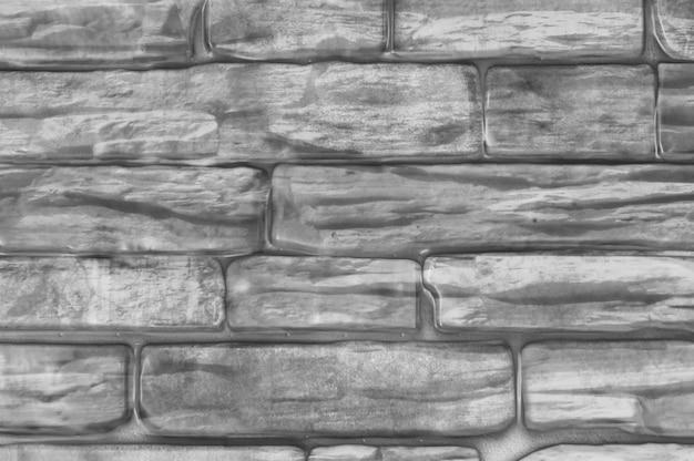 Die backsteinmauer des hauses ist schwarz und weiß. Premium Fotos