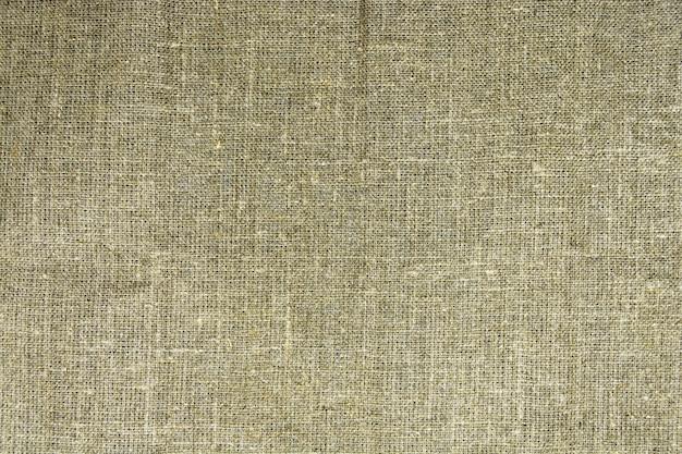 Die dichte textur der alten leinwand, ein stoff aus flachs Premium Fotos