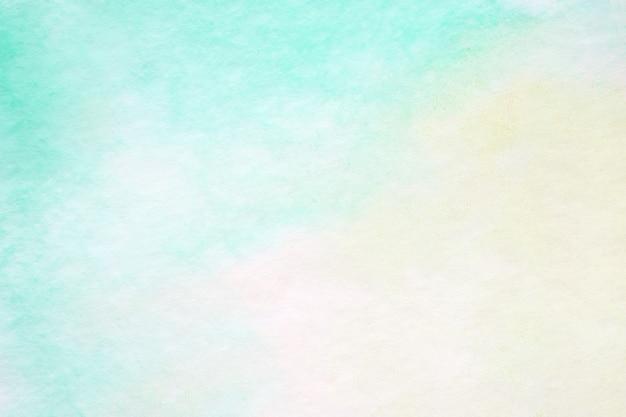 Die grüne abstrakte aquarellmalerei, die auf weißbuchhintergrund, kunst und handwerk gemasert wird, entwerfen hintergrund Premium Fotos